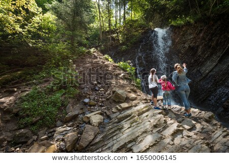 Family walking through countryside Stock photo © monkey_business