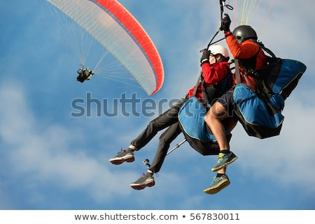 Paragliding in tandem, extreme sport, free gliding and blue sky  Stock photo © smuki