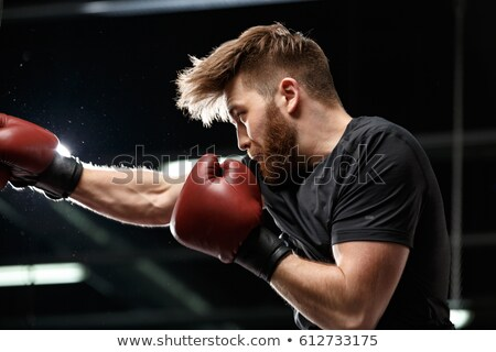 Concentrated handsome young strong sports man boxer Stock photo © deandrobot