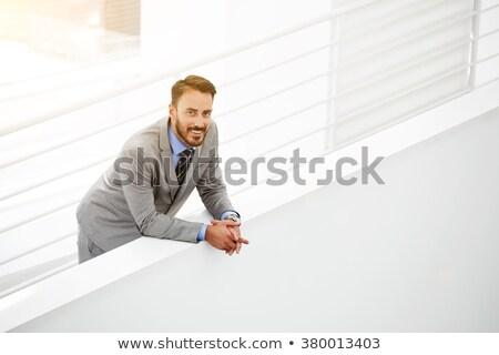 Portrait of man near ladder Stock photo © deandrobot
