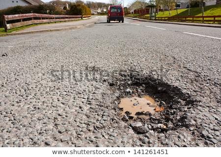 asphalt road hole damage stock photo © stevanovicigor