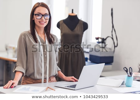 Portrait of a beautiful fashion designer woman working at workshop Stock photo © deandrobot