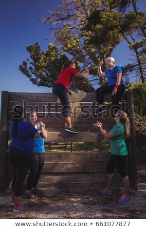 Groep geschikt vrouwen high five ander boot Stockfoto © wavebreak_media