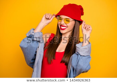 brunette model with red lips and sunglasses on head in body stock photo © julenochek