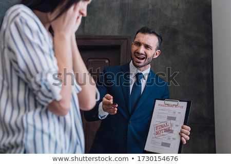 angry business woman pointing finger foreclosure stock photo © qingwa