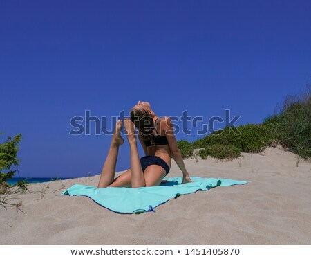 Wonderful model in bikini posing on beach Stock photo © dash
