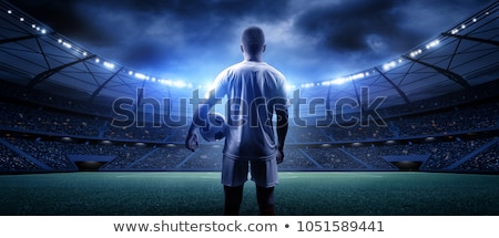 Futbolista listo patear balón de fútbol suelo hierba Foto stock © wavebreak_media