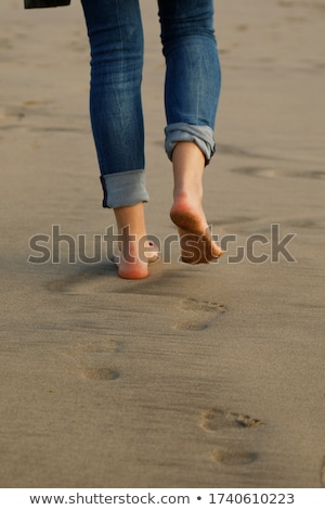 Low Section View Of Person's Wet Jeans Stock photo © AndreyPopov