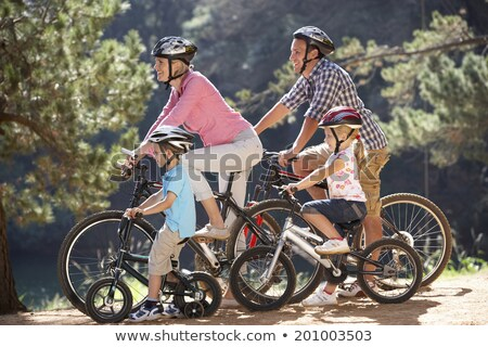 Boy and girl sharing bike in countryside Stock photo © IS2