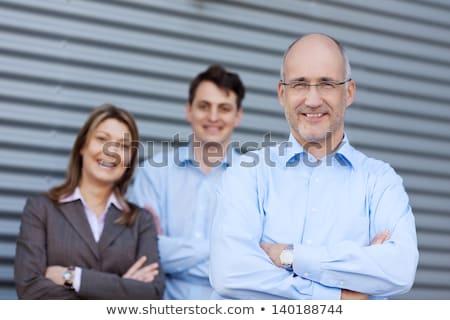 Portré három kollégák nő iroda férfi Stock fotó © IS2