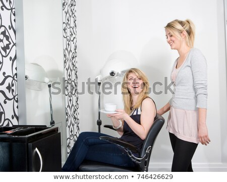 Hairdresser serving coffee to customer Stock photo © IS2