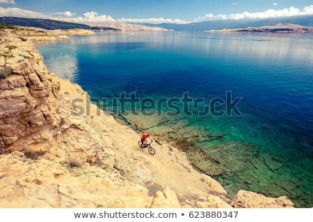Stock photo: Mountain biking at the seaside bike dirt enduro trail