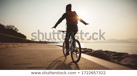 mountain biking at the seaside bike trail stock photo © blasbike