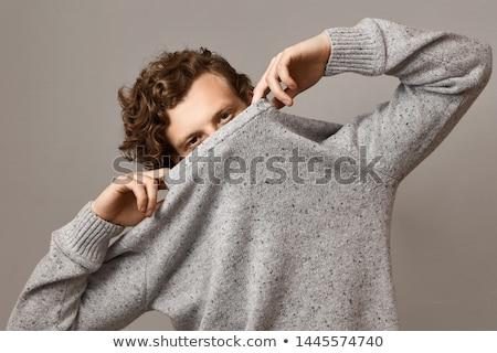Férfi köt pulóver jókedv ül szabadidő Stock fotó © IS2