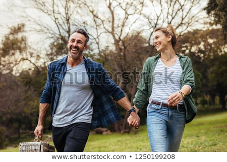 laughing young casual couple holding hands stock photo © feedough