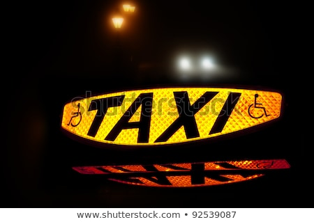 lit taxi sign at night stock photo © is2