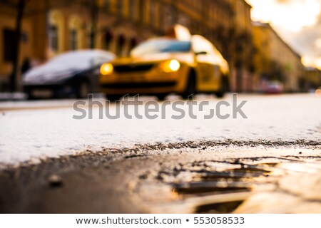 Taxi parked by building, close up Stock photo © IS2