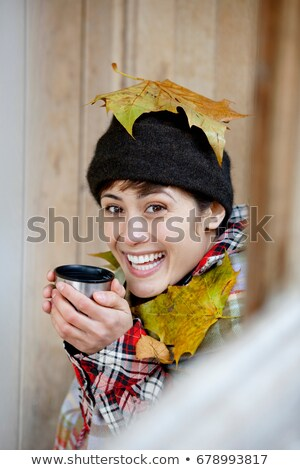 Woman with leaves and hot drink in hut Stock photo © IS2