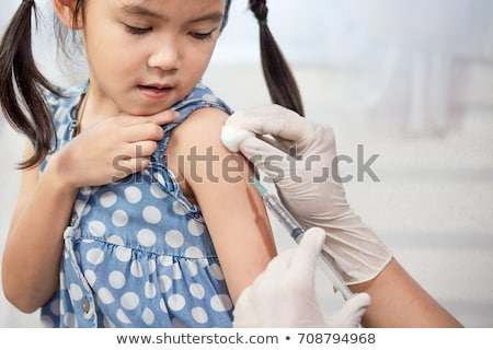 Girl getting immunization Stock photo © IS2
