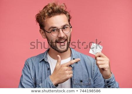 Persoon condoom hand Stockfoto © AndreyPopov