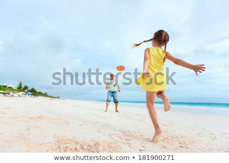 kids playing frisbee at beach stock photo © bluering