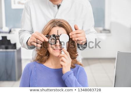 woman with optician at eyesight test for glasses stock photo © kzenon