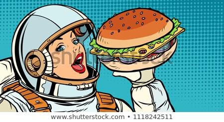 Hungry woman astronaut eating Burger Stock photo © studiostoks