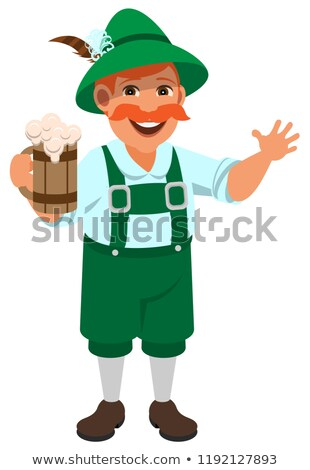 German man in national retro clothes holding wooden mug of beer Stock photo © orensila