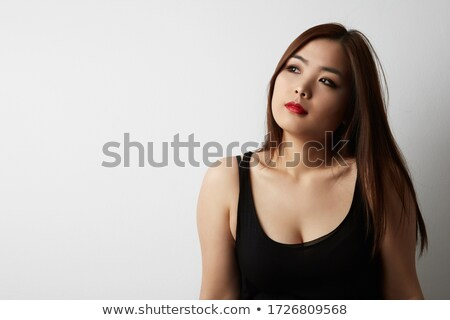 Alegre Asia mujer largo pelo oscuro mirando Foto stock © deandrobot