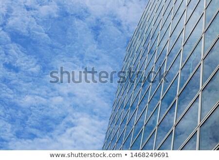 Skyscraper facade with clouds Stock photo © 5xinc