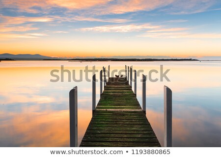 Perfect serenity - timber jetty and reflections Stock photo © lovleah