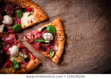delicious italian pizza served on wooden table stock photo © dash