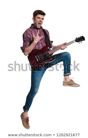 Fiatalember elektromos gitár sikít készít agancs felirat Stock fotó © feedough