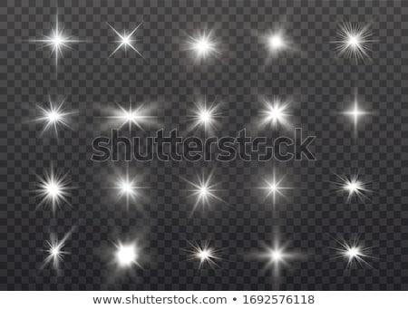 Transparent glow light effect. Star burst with sparkles. White glitter. Vector illustration Stock photo © olehsvetiukha