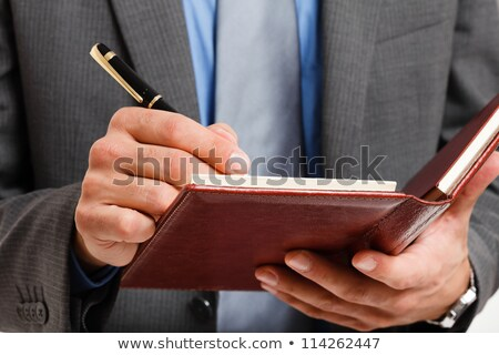 Detail of a businessman writing on his agenda Stock photo © Minervastock