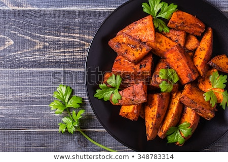 Fresh organic orange sweet potato on dark background. stock photo © szefei