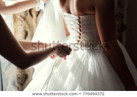 Morning of the bride when she wears a beautiful dress, woman getting ready before wedding ceremony Stock photo © ruslanshramko