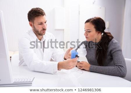 Orvos információ oxigénmaszk nő fiatal férfi orvos Stock fotó © AndreyPopov