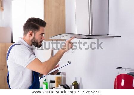 Ezermester konyha szűrő munka dolgozik szolgáltatás Stock fotó © AndreyPopov