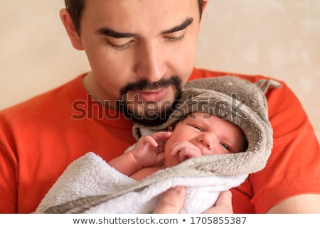 close up portrait of a happy man wrapped in a blanket stock photo © deandrobot