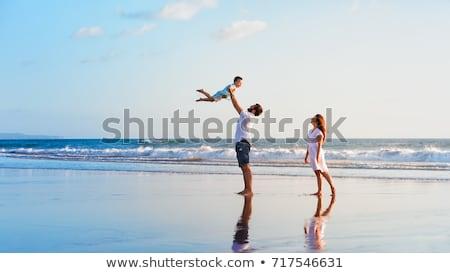 Boldog család apa anya fiú jókedv naplemente Stock fotó © Lopolo