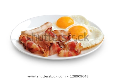 Fried eggs and bacon on the white plate Stock photo © Alex9500