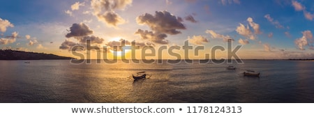 traditional balinese boat jukung at jimbaran beach at sunset in bali indonesia photo from the drone stock photo © galitskaya