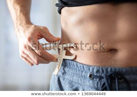 Persona cuerpo grasa primer plano atleta Foto stock © AndreyPopov
