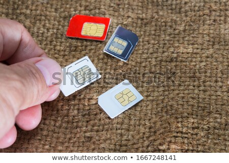 Human's Hand Selecting Sim Cards Stock photo © AndreyPopov