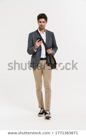 Afbeelding mannelijk suits smartphone lopen Stockfoto © deandrobot