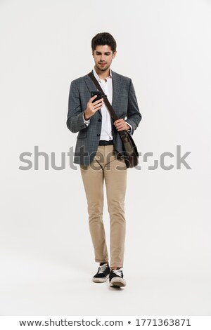 Obraz męski garnitury smartphone spaceru Zdjęcia stock © deandrobot