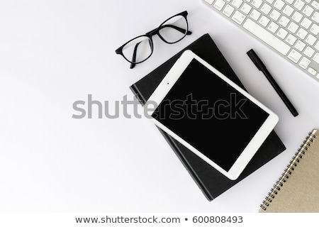 Stock photo: Office workplace table with glasses, supplies and computer