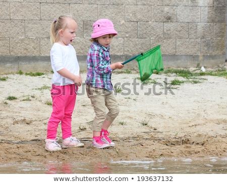 Cute · девушки · мальчика · озеро · воды - Сток-фото © lopolo