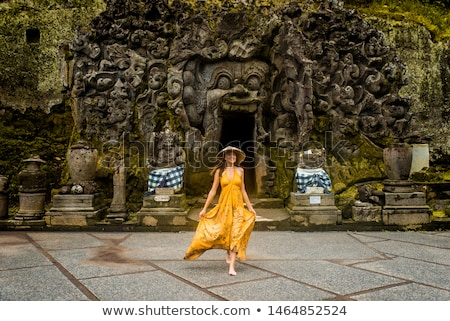 woman tourist in old hindu temple of goa gajah near ubud on the island of bali indonesia stock photo © galitskaya